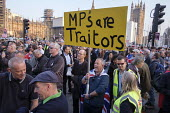 MPs Are Traitors. Pro Brexit protest outside Parliament on the day the UK was scheduled to leave the EU, Westminster, London - Philip Wolmuth - 2010s,2019,activist,activists,against,Brexit,CAMPAIGNING,CAMPAIGNS,DEMONSTRATING,demonstration,EU,Europe,European Union,Leave,London,MP,MPs,outside,Parliament,placard,placards,politician,politicians,p