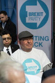 Campaign T-shirt, supporters gathering, Brexit Party launch, Coventry. European Parliament elections campaign - John Harris - 2010s,2019,age,ageing population,Brexit,campaign,campaigning,CAMPAIGNS,Coventry,DEMOCRACY,elderly,ELECTION,elections,EU,European Union,Far Right,Far Right,launch,Leave,male,man,men,nationalism,old,Par