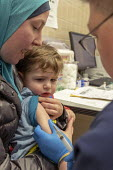 Southfield, Michigan USA: MMR vaccination against a measles outbreak, Oakland County Health Department. Twenty-two measles cases have been confirmed in the area - Jim West - 2010s,2019,adult,adults,against,America,american,americans,ANXIETY,ANXIOUSNESS,apprehension,apprehensive,boy,BOYS,child,CHILDHOOD,children,contagious,disease,DISEASES,dress,EARLY YEARS,FAMILY,fear,fea