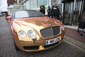 Chauffeur driven gold Bentley with MR L1ON number plate outside the Grand Hotel, Brighton. Bentley Continental GT V8 S is owned by Dave Day who founded the Golden Lion chain of pubs - John Harris - 15-09-2015