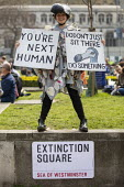 Extinction Square, Extinction Rebellion protest, Parliament Square against lack of government action on climate change. Nonviolent direct action simultaneous blocking London - Jess Hurd - 17-04-2019