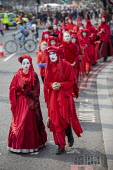 The Invisible Circus, Extinction Rebellion activists dressed in red robes and with white makeup, Extinction Rebellion protest, Parliament Square against lack of government action on climate change. No... - Jess Hurd - 17-04-2019