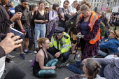 Police arresting Extinction Rebellion climate change campaigners, occupation of Oxford Circus, London - Philip Wolmuth - 2010s,2019,activist,activists,adult,adults,against,ARREST,ARRESTED,arresting,CAMPAIGN,campaigner,campaigners,CAMPAIGNING,CAMPAIGNS,civil disobedience,Climate Change,CLJ,DEMONSTRATING,demonstration,DEM