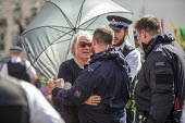 Woman hugs a police officer after being released from a lock-on during eviction of Extinction Rebellion climate change campaigners, occupation of Oxford Circus, London. - Jess Hurd - 19-04-2019