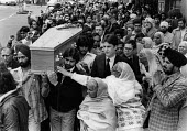 Funeral of Blair Peach, Southall, London 1979. Peach was a teacher who had supported the protest against a National Front meeting in Southall on the 23rd April 1979, and during the protest was killed... - John Sturrock - 1970s,1979,activist,activists,adult,adults,against,Anti Racism,anti racist,Asian,Asians,BAME,BAMEs,Belief,bigotry,Black,BME,bmes,bodies,body,CAMPAIGN,campaigner,campaigners,CAMPAIGNING,CAMPAIGNS,caske