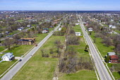 Detroit, Michigan, USA, Depopulation. Huge sections of vacant land in many Detroit neighborhoods. The city's population has fallen from 1.86 million in 1950 to an estimated 673,000 in 2017 - Jim West - 2010s,2019,abandoned,aerial,american,americans,cities,city,depopulation,Detroit,EBF,Economic,Economy,empty,fallen,highway,house,houses,Housing,land,Michigan,midwest,neighborhood,population,population