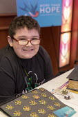Mt. Pleasant, Michigan, USA, 420 Canna Expo, autistic Jayden Carter, 12, at the More Than Hope booth. Jayden's mother, Amie Carter, says her son has shown dramatic improvement since he began using can... - Jim West - 20-04-2019