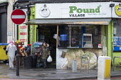Pound Village corner shop, Sparkbrook, Birmingham - John Harris - 2010s,2019,BAME,BAMEs,Birmingham,Black,BME,bmes,bought,buying,cities,City,consumer,consumers,customer,customers,diversity,ethnic,ethnicity,excluded,exclusion,HARDSHIP,impoverished,impoverishment,INEQU