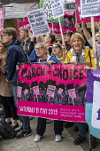 Abortion rights campaigners March for Choice counter the March For Life anti abortion rally, Parliament Square, London - Jess Hurd - 2010s,2019,Abortion,activist,activists,against,anti abortion,banner,banners,CAMPAIGN,campaigners,CAMPAIGNING,CAMPAIGNS,counter,DEMONSTRATING,Demonstration,equal rights,equality,FEMALE,feminism,feminis