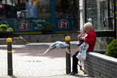 Pensioner checking her purse, High Street, Merthyr Tydfil, South Wales - John Harris - 15-05-2019
