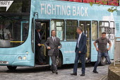Nigel Farage Brexit Party walking down the High Street Merthyr Tydfil, South Wales, Nathan Gill (R) and campaign bus - John Harris - 2010s,2019,Brexit,Brexit Party,bus,bus service,buses,campaign,campaigning,CAMPAIGNS,DEMOCRACY,election,elections,EU,European Parliament election,European Union,far right,far right,funny,humor,humorous