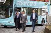 Nigel Farage Brexit Party walking down the High Street Merthyr Tydfil, South Wales, Nathan Gill (R) and campaign bus - John Harris - 15-05-2019