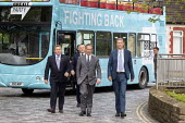 Nigel Farage Brexit Party walking down the High Street Merthyr Tydfil, South Wales, Nathan Gill (R) and campaign bus - John Harris - 2010s,2019,bodyguard,bodyguards,Brexit,Brexit Party,bus,bus service,buses,campaign,campaigning,CAMPAIGNS,DEMOCRACY,election,elections,EU,European Parliament election,European Union,far right,far right