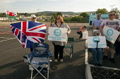 Supporters, Brexit Party Rally, Merthyr Tydfil, South Wales - John Harris - 2010s,2019,Brexit,Brexit Party,campaign,campaigning,CAMPAIGNS,DEMOCRACY,election,elections,EU,European Parliament election,European Union,far right,far right,FEMALE,flag,flags,Leave,Merthyr,nationalis