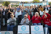 Supporters, Brexit Party Rally, Merthyr Tydfil, South Wales - John Harris - 2010s,2019,applauding,applause,Brexit,Brexit Party,campaign,campaigning,CAMPAIGNS,DEMOCRACY,election,elections,EU,European Parliament election,European Union,far right,far right,FEMALE,Leave,Merthyr,n