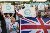 Supporters, Brexit Party Rally, Merthyr Tydfil, South Wales - John Harris - 2010s,2019,applauding,applause,Brexit,Brexit Party,campaign,campaigning,CAMPAIGNS,DEMOCRACY,election,elections,EU,European Parliament election,European Union,far right,far right,FEMALE,flag,flags,Leav