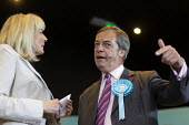 Nikki Page and Nigel Farage, Brexit Party rally, Willenhall, Wolverhampton - John Harris - 2010s,2019,Brexit,Brexit Party,campaign,campaigning,CAMPAIGNS,communicating,communication,conversation,conversations,DEMOCRACY,dialogue,discourse,discuss,discusses,discussing,discussion,election,elect