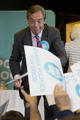Nigel Farage signing autographs, Brexit Party rally, Willenhall, Wolverhampton - John Harris - 2010s,2019,autograph,AUTOGRAPHS,Brexit,Brexit Party,campaign,campaigning,CAMPAIGNS,communicating,communication,DEMOCRACY,election,elections,EU,European Parliament election,European Union,far right,far