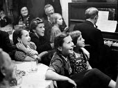 Children and adults alike being entertained, Munich Bier Theater Germany 1949, locals being entertained in a Beer Theater. These venues provided family entertainment for both young and old - Hannes Rosenberg - 06-07-1949