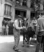 Film Director John Huston on the set of Moulin Rouge 1952 Paris, France stroking a horse - Ina Bandy - 1950s,1952,ACE,ACE arts,acting,Actor,actor actors,actors,adult,adults,Arts,cinema,costume drama,culture,directing,director,directors,Domesticated Ungulates,entertainment,equestrian,film,film making,Fi