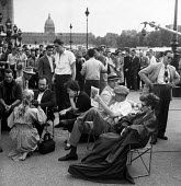 A break during the filming of Moulin Rouge 1952 Paris France. Actors Colette Marchand as Marie Charlet and Jose Ferrer as painter Toulouse Lautrec - Ina Bandy - 1950s,1952,ACE,ACE arts,ACTING,Actor,actor actors,actors,actress,actresses,adult,adults,Arts,break,camera,cameras,cinema,costume drama,culture,directing,director,directors,dolly,entertainment,film,fil