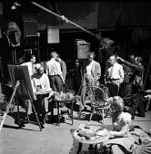 Film Director John Huston (C) on the set of Moulin Rouge Paris France 1952. Jose Ferrer as painter Toulouse Lautrec (L) with Oswald Morris (behind) - Ina Bandy - 1950s,1952,ACE,ACE arts,acting,Actor,actor actors,actors,actress,actresses,adult,adults,Arts,camera,cameras,cinema,costume drama,culture,directing,director,directors,dolly,entertainment,film,film came