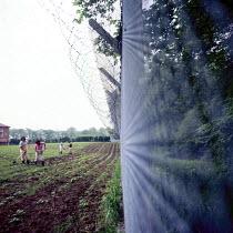 Women prisoners working in a field, Styal Prison Wilmslow Cheshire 1959Women prisoners working in a field, Styal Prison Wilmslow Cheshire 1959Women prisoners working in a field, Styal Prison Wilmslow... - Malcolm Aird - 26-04-1959