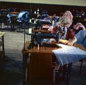 Female inmates earning their prison allowance in the sewing workshop of Styal Prison Wilmslow Cheshire 1959Female inmates earning their prison allowance in the sewing workshop of Styal Prison Wilmslow... - Malcolm Aird - 1950s,1959,CLJ,cotton,crime,employee,employees,Employment,female,HMP Styal,imprisonment,incarcerated,incarceration,inmate,inmates,jail,jailed,jails,job,jobs,justice,law,LBR,London,older,penal system,p