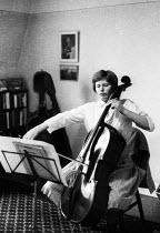 Jacqueline du Pre practising cello at home London 1962