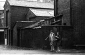 Two girls walking home from school, Blackpool 1965Two girls walking home from school, Blackpool 1965Two girls walking home from school, Blackpool 1965Two girls walking home from school, Blackpool 1965 - Romano Cagnoni - 01-10-1965