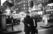 Couple walking on Piccadilly, evening rush hour London 1961Couple walking on Piccadilly, evening rush hour London 1961Couple walking on Piccadilly, evening rush hour London 1961Couple walking on Picca... - Romano Cagnoni - 08-10-1961