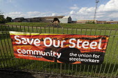 British Steel Scunthorpe. Community union Save Our Steel banner. Sculpture of molten slag being poured from a slag pot onto a waste tip. Greybull Capital has put British Steel into receivership. Linco... - John Harris - 2010s,2019,artwork,bankrupt,bankruptcy,banner,banners,Capital,capitalism,communities,Community,Community Union,EBF,Economic,Economy,factory,Industries,industry,Job Losses,jobs,Lincolnshire,liquidated,