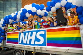 NHS staff float, Birmingham Gay Pride. - Jess Hurd - 2010s,2019,ACE,activist,activists,against,banner,banners,Birmingham,Birmingham Gay Pride 2019,CAMPAIGNING,CAMPAIGNS,color,colorful,colorfull,colors,colour,colourful,colours,Culture,DEMONSTRATING,demon