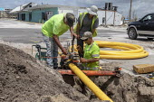 Mexico Beach, Florida, USA: Workers replacing a gas pipe 7 months after the town was devastated by Hurricane Michael - Jim West - 09-05-2019