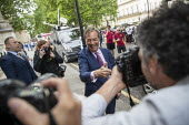 Nigel Farage arriving for a Brexit Party victory press conference European Elections, London - Jess Hurd - 27-05-2019