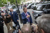 Nigel Farage arriving for a Brexit Party victory press conference European Elections, London - Jess Hurd - 2010s,2019,ARRIVAL,arrivals,arrive,arrived,arrives,arriving,Brexit,Brexit Party,camera,cameras,conference,conferences,DEMOCRACY,election,Elections,EU,European,European Union,journalism,journalist,jour