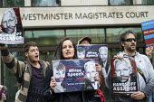 Protest at Julian Assange hearing on the US extradition request, Westminster Magistrates Court, London. The indictment has been condemned by free press organisations as criminalising journalism - Jess Hurd - 2010s,2019,activist,activists,against,american,americans,CAMPAIGNING,CAMPAIGNS,Court,DEMONSTRATING,demonstration,extradition,Free Speech,freedom of the press,hearing,Human Rights,information,journalis