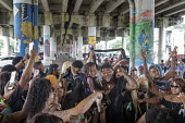 New Orleans, Louisiana, USA: Funeral procession ends under the Interstate highway - Jim West - 2010s,2019,ACE,African American,African Americans,African-American,America,art,arts,BAME,BAMEs,band,bands,Belief,black,BME,bmes,brass band,CELEBRATE,CELEBRATING,celebration,CELEBRATIONS,cities,City,co