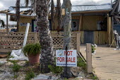 Mexico Beach, Florida, USA: A home with a Not For Sale sign. Destruction from Hurricane Michael 7 months after the storm hit the Florida Panhandle - Jim West - 2010s,2019,America,american,americans,Beach,BEACHES,CLIMATE,Climate Change,coast,coastal,coasts,communicating,communication,conditions,damage,damaged,destroyed,destruction,devastation,DIA,Disaster,dis