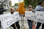 Anti Donald Trump placards, state visit by the US President, Parliament Square, London. Impeachment is Coming, Mueller No Exoneration implying Russian interference in American politics - Jess Hurd - 03-06-2019