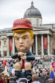 Marionette of President Trump sitting on a toilet tweeting, Together Against Trump, stop the state visit protest against Donald Trump, London - Jess Hurd - 2010s,2019,activist,activists,against,anti,art,CAMPAIGN,campaigner,campaigners,CAMPAIGNING,CAMPAIGNS,communicating,communication,DEMONSTRATING,demonstration,DEMONSTRATIONS,Donald Trump,figure,figures,