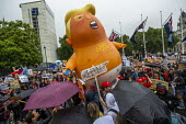 Trump blimp, Together Against Trump, stop the state visit protest against Donald Trump, London - Jess Hurd - 2010s,2019,activist,activists,against,anti,balloon,balloons,blimp,CAMPAIGN,campaigner,campaigners,CAMPAIGNING,CAMPAIGNS,DEMONSTRATING,demonstration,DEMONSTRATIONS,Donald Trump,London,Protest,PROTESTER
