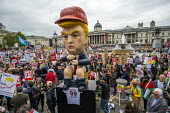 Marionette of President Trump sitting on a toilet tweeting, Together Against Trump, stop the state visit protest against Donald Trump, London - Jess Hurd - 04-06-2019