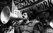 Tariq Ali speaking, Imperial Typewriters Strike for equal pay protest rally, Leicester 1974 - John Sturrock - International Marxist Group,1970s,1974,activist,activists,against,Asian,Asians,BAME,BAMEs,banner,banners,bigotry,Black,BME,bmes,CAMPAIGNING,CAMPAIGNS,DEMONSTRATING,Demonstration,DISCRIMINATION,dispute