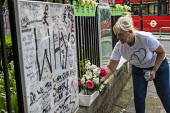 Local residents marking the 2nd anniversary of the Grenfell fire, Kensington, London. - Jess Hurd - 2010s,2019,2nd anniversary,activist,activists,against,anniversary,CAMPAIGN,campaigner,campaigners,CAMPAIGNING,CAMPAIGNS,DEMONSTRATING,Demonstration,DEMONSTRATIONS,fire,fires,floral tribute,floral trib