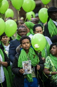 Grenfell fire 2nd anniversary memorial procession from St Helen's Church, Kensington, London - Jess Hurd - 2010s,2019,2nd,2nd anniversary,activist,activists,against,anniversary,balloon,balloons,BAME,BAMEs,Black,BME,bmes,CAMPAIGN,campaigner,campaigners,CAMPAIGNING,CAMPAIGNS,child,CHILDHOOD,children,Church,c