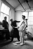 Franco Zeffirelli helping to fit a fat prosthetic body onto a character, directing Falstaff, Royal Opera House London 1961Franco Zeffirelli helping to fit a fat prosthetic body onto a character, direc... - Romano Cagnoni - 1960s,1961,ACE,adult,adults,Arts,bodies,body,costume,costume department,culture,directing,director,directors,fat,Franco,Franco Zeffirelli,helping,House,houses,London,maker,makers,making,MATURE,opera,o