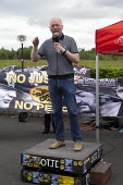 Matt Wrack speaking, Orgreave 35th Anniversary Rally, Orgreave, Sheffield, South Yorkshire - John Harris - 2010s,2019,activist,activists,against,Anniversary,banner,banners,Battle of Orgreave,CAMPAIGNING,CAMPAIGNS,COMMEMORATE,COMMEMORATING,commemoration,COMMEMORATIONS,commemorative,DEMONSTRATING,Demonstrati