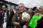 Geoff Poulter ex Bolsover miner helmet and badges, Orgreave 35th Anniversary Rally, Orgreave, Sheffield, South Yorkshire - John Harris - 2010s,2019,activist,activists,against,age,ageing population,Anniversary,Battle of Orgreave,CAMPAIGN,campaigner,campaigners,CAMPAIGNING,CAMPAIGNS,COMMEMORATE,COMMEMORATING,commemoration,COMMEMORATIONS,