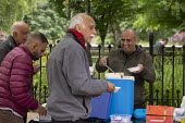 Street soup kitchen for the homeless, Manchester. Curry and tea provided by local volunteers - John Harris - 2010s,2019,age,ageing population,BAME,BAMEs,Black,BME,bmes,cities,City,diversity,elderly,ethnic,ethnicity,excluded,exclusion,feed,feeding,feeds,food,FOODS,HARDSHIP,homeless,homelessness,impoverished,i